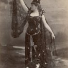 Public domain image of Victorian witch costume.
